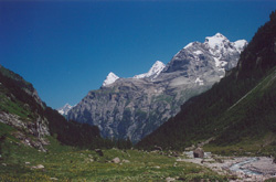 Chilchbalm. Looking back from the end of the Lauterbrunnen Valley: Eiger, Monch, and Jungfrau.