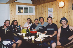 Cheese fondue. It's what's for dinner. A very happy table includes Eli, Alana, Jessy, Nicole, Mike, Alex, and Sebastian.
