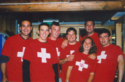 It's August 1st, 2002. Swiss National Day. Don, Kevin, Jim, Nigel, Amy, Brian, and Alex are in Swiss colors.