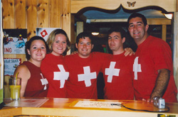 Amy, Kim, Nigel, Alex, and Brian at the bar on Swiss National Day